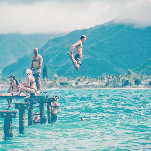 Men jumping in water